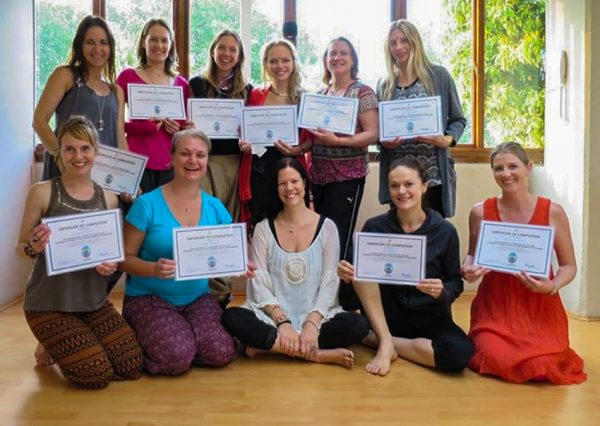 2018 graduates with Bryony and their certificates from the YogaBeez advanced children's yoga teacher training course