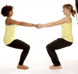 Teen yoga - partner chair pose