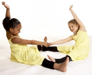 Children's yoga - partner pose side stretch