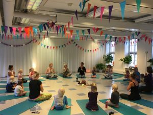 YogaBeez Teachers practicing a hands-on teaching lesson in the training, Helsinki